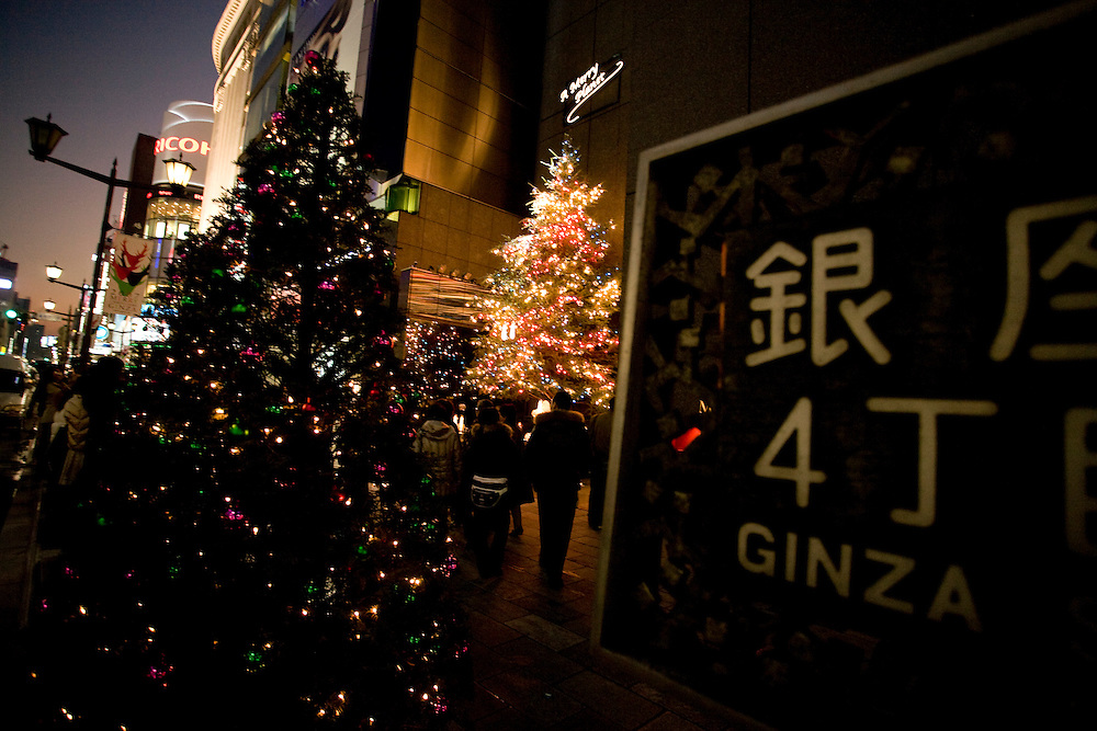 Shoppers using cell phones to photograph  Christmas lights in Tokyo's Ginza district