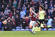 Bournemouth Defender, Nathan Ake (5) and Burnley Midfielder, Scott Arfield (37)  during the Premier League match between Burnley and Bournemouth at Turf Moor, Burnley, England on 10 December 2016. Photo by Mark Pollitt.