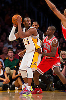 25 December 2011: Guard Kobe Bryant of the Los Angeles Lakers looks to pass while being guarded by Ronnie Brewer of the Chicago Bulls during the first half of the Bulls 88-87 victory over the Lakers at the STAPLES Center in Los Angeles, CA.