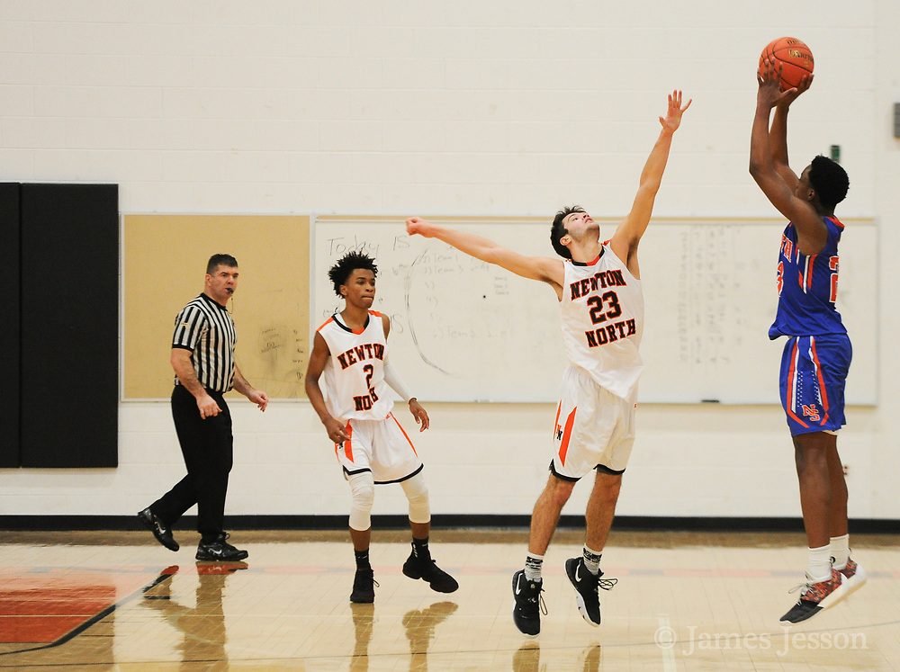Newton South junior Njavan Stewart-Okiwe takes a shot during the game against Newton North at Newton North, Dec. 27, 2018.   [Wicked Local Photo/James Jesson]