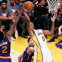 06 November 2016: Los Angeles Lakers guard Nick Young (0) is fouled by Phoenix Suns guard Eric Bledsoe (2) during the LA Lakers 119-108 victory over the Phoenix Suns, at the Staples Center, Los Angeles, California, USA.