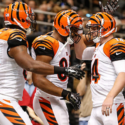 Nov 16, 2014; New Orleans, LA, USA; Cincinnati Bengals tight end Jermaine Gresham (84) celebrates a touchdown with quarterback Andy Dalton (14) and tight end Kevin Brock (83) during the third quarter of a game against the New Orleans Saints at the Mercedes-Benz Superdome. The Bengals defeated the Saints 27-10. Mandatory Credit: Derick E. Hingle-USA TODAY Sports
