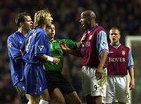 Photo. Richard Lane. <br />Aston Villa v Birmingham City. Barclaycard Premiership. 03/03/2003<br />Ref. Mark Halsey gets between Robbie Savage and Dion Dublin before the flair up.