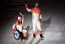The final torch bearers during the opening ceremony of the PyeongChang 2018 Winter Paralympics at the PyeongChang Olympic Stadium in South Korea.