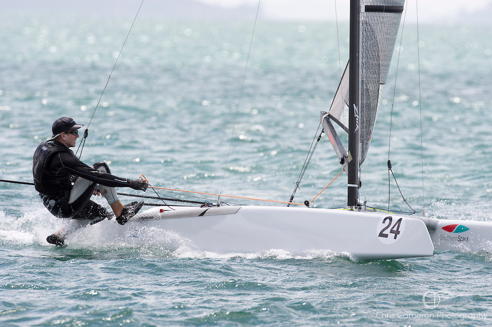 Peter Burling (NZL275) rounds the top mark in race three of the A Class World championships regatta being sailed at Takapuna in Auckland. 12/2/2014