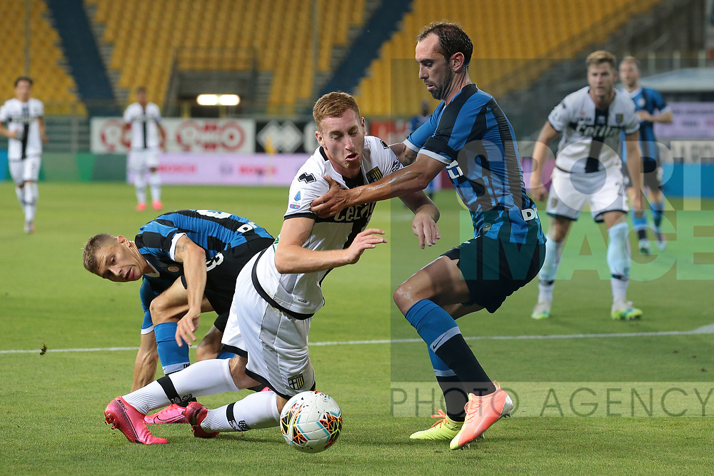 Parma Calcio's Swedish midfielder Dejan Kulusevski goes down under challenge from Inter's Italian midfielder Nicolo Barella and Uruguayan defender Diego Godin during the Serie A match at Stadio Ennio Tardini, Parma. Picture date: 28th June 2020. Picture credit should read: Jonathan Moscrop/Sportimage