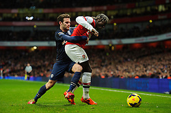 Arsenal Defender Bacary Sagna (FRA) is challenged by Man Utd Forward Juan Mata (ESP) - Photo mandatory by-line: Rogan Thomson/JMP - 07966 386802 - 12/02/14 - SPORT - FOOTBALL - Emirates Stadium, London - Arsenal v Manchester United - Barclays Premier League.