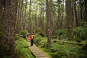 Guests from the National Geographic Sea Lion hike through the forest at SGang Gwaay, a UNESCO World Heritage Site in Haida Gwaii.