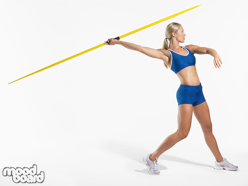 Female athlete preparing to throw javelin side view