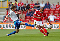 Photo: Leigh Quinnell.<br /> Nottingham Forest v Brighton & Hove Albion. Coca Cola League 1. 19/08/2006. Brightons Dean Hammond leaps into action against Nottingham Forests Julian Bennett.
