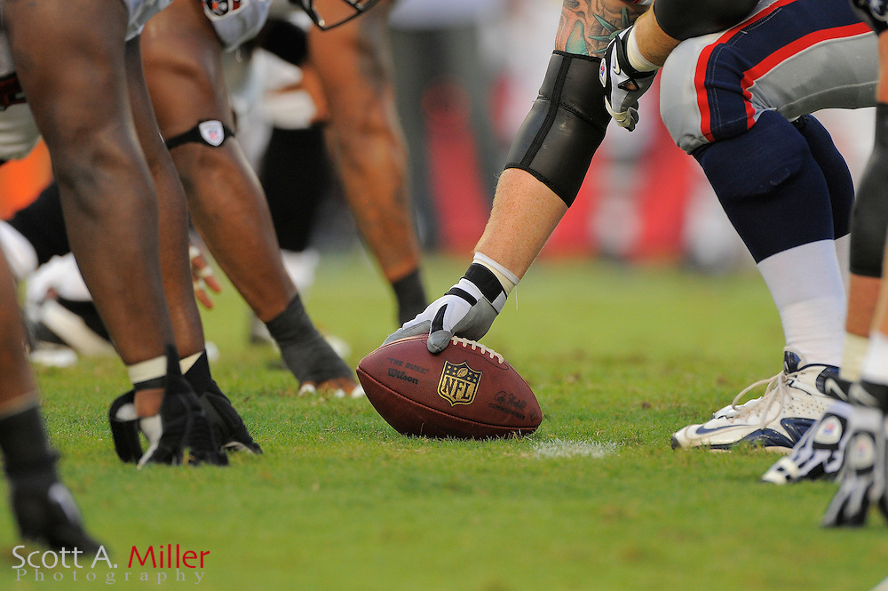 Detail of center over the ball during the Tampa Bay Buccaneers game against the New England Patriots at Raymond James Stadium on Aug. 18, 2011 in Tampa, Fla...©2011 Scott A. Miller.