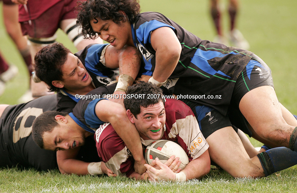 Harbour's Tane Hart is smothered by four Waicoa Bay players during the Bartercard Cup rugby league match between Harbour League and Waicoa Bay Stallions at Mt Smart Stadium no.2 , Auckland, New Zealand on Saturday 7 July 2007. Photo: Hagen Hopkins/PHOTOSPORT