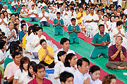 "Sept. 26, 2009 -- PATTANI, THAILAND:  Buddhists pray during the Tak Bat Sankatan ceremony in Pattani, Thailand, Saturday. Buddhists in Thailand's three southern most provinces gathered in Pattani Saturday, Sept 26 to celebrate Tak Bat Sankatan, the day Lord Buddha returned to earth and was greeted by a crawd of his disciples and Buddhist believers who were waiting to offer him food. Buddhists monks representing the 266 ""Wats"" (temples) in the three provinces (Pattani, Narathiwat and Yala) processed through the crowd and were presented with food and gifts.   Photo by Jack Kurtz"