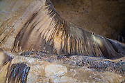 """Abstract pattern in Caverns of Sonora, Sutton County, Texas, USA. The world-class Caverns of Sonora have a stunning and sparkling array of speleothems (helictites, stalactites, stalagmites, flowstone, coral trees, and other calcite crystal formations). National Speleological Society co-founder, Bill Stephenson said, after seeing it for the first time, """"The beauty of Caverns of Sonora cannot be exaggerated...not even by a Texan!"""" Geologically, the cave formed between 1.5 to 5 million years ago within 100-million-year-old (Cretaceous) Segovia limestone, of the Edward limestone group. A fault allowed gases to rise up to mix with aquifer water, making acid which dissolved the limestone, leaving the cave. Between 1 and 3 million years ago, the water drained from the cave, after which speleothems begain forming. It is one of the most active caves in the world, with over 95% of its formations still growing. Sonora Caves are on Interstate 10, about half-way between Big Bend National Park and San Antonio, Texas."""