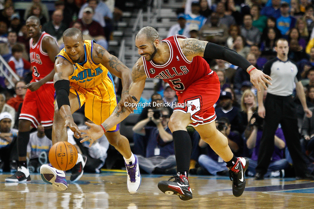 February 12, 2011; New Orleans, LA, USA; New Orleans Hornets power forward David West (30) and Chicago Bulls power forward Carlos Boozer (5) scramble for a loose ball during the third quarter at the New Orleans Arena.  The Bulls defeated the Hornets 97-88. Mandatory Credit: Derick E. Hingle