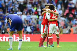 Aaron Ramsey of Arsenal, Nacho Monreal and Mohamed Elneny celebrate beating Chelsea 2-1 in the FA Cup final  - Mandatory by-line: Dougie Allward/JMP - 27/05/2017 - FOOTBALL - Wembley Stadium - London, England - Arsenal v Chelsea - Emirates FA Cup Final