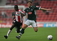 Photo: Lee Earle.<br /> Southampton v Plymouth Argyle. Coca Cola Championship. 16/09/2006. Plymouth's Akos Buzsaky (R) battles with Nathan Dyer.