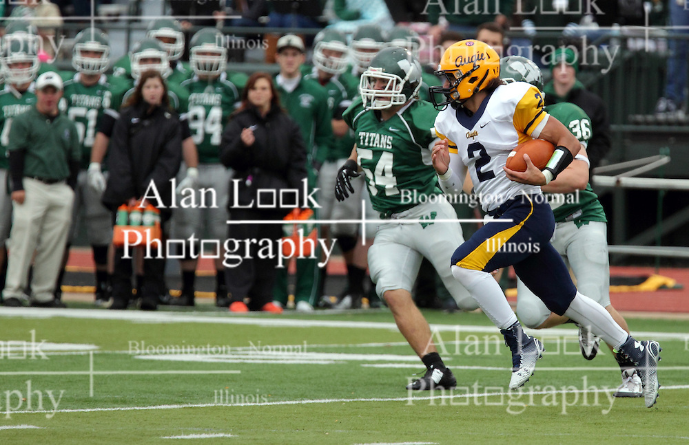 18 October 2014: Sean Garvey chases Sam Frasco  during an NCAA division 3 football game between the Augustana Vikings and the Illinois Wesleyan Titans in Tucci Stadium on Wilder Field, Bloomington IL