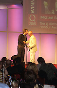 Chris Martin and Michael Eavis.  The Q Awards, the  magazine's annual music awards,  Grosvenor House. October 10 2005. ONE TIME USE ONLY - DO NOT ARCHIVE © Copyright Photograph by Dafydd Jones 66 Stockwell Park Rd. London SW9 0DA Tel 020 7733 0108 www.dafjones.com