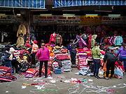 "22 DECEMBER 2017 - HANOI, VIETNAM:  The wholesale clothes and fabric section of Dong Xuan Market in the old quarter of Hanoi. The old quarter is the heart of Hanoi, with narrow streets and lots of small shops but it's being ""gentrified"" because of tourism and some of the shops are being turned into hotels and cafes for tourists and wealthy Vietnamese.   PHOTO BY JACK KURTZ"