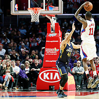 25 March 2016: LA Clippers guard Jamal Crawford (11) takes a jump shot over Utah Jazz forward Trey Lyles (41) during the Los Angeles Clippers 108-95 victory over the Utah Jazz, at the Staples Center, Los Angeles, California, USA.