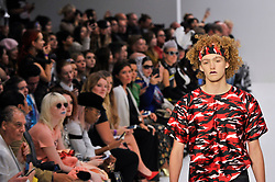 """© Licensed to London News Pictures. 16/09/2017. London, UK. A model presents a look from Rira Sugawara's """"Dans La Vie"""" collection at Fashion Scout in Covent Garden, one of the many venues hosting London Fashion Week SS18.  Photo credit : Stephen Chung/LNP"""