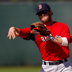 February 23, 2011; Fort Myers, FL, USA; Boston Red Sox second baseman Dustin Pedroia (15) during spring training at the Player Development Complex.  Mandatory Credit: Derick E. Hingle