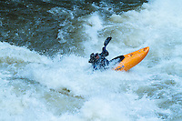 Man kayaking on the North Fork of the Nehalem River on the Oregon coast.