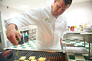 Chef Patrick Kander prepares a meal in one of the new kitchens at the Cleveland Culinary Launch & Kitchen on April 18, 2013.