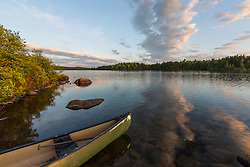 A canoe on the shore of Long Pond in Maine's north woods. Near the Appalachian Trail and the Appalachian Mountain Club's Gorman Chairback Lodge.