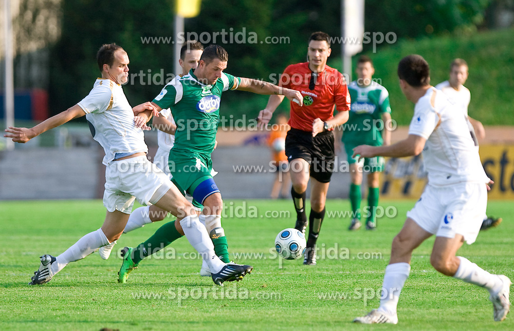 Aris Zarifovic of Gorica vs Sebastjan Cimirotic of Olimpija  at football match between NK Olimpija vs Hit Gorica in 11th Round of Prva liga 2009 - 2010,  on September 27, 2009, in ZSD Ljubljana, Ljubljana, Slovenia.  (Photo by Vid Ponikvar / Sportida)