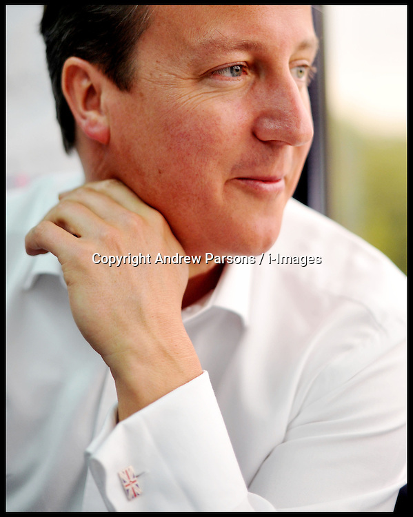 The Prime Minister David Cameron working on the train to Cardiff, Tuesday July 26, 2011.  Photo By Andrew Parsons / i-Images.
