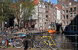 Amsterdam, Holland:  A sunny Sunday afternoon scene on the Oudezijds Voorburgwal, one of the city's colorful canals at the beginning of the Red Light District.