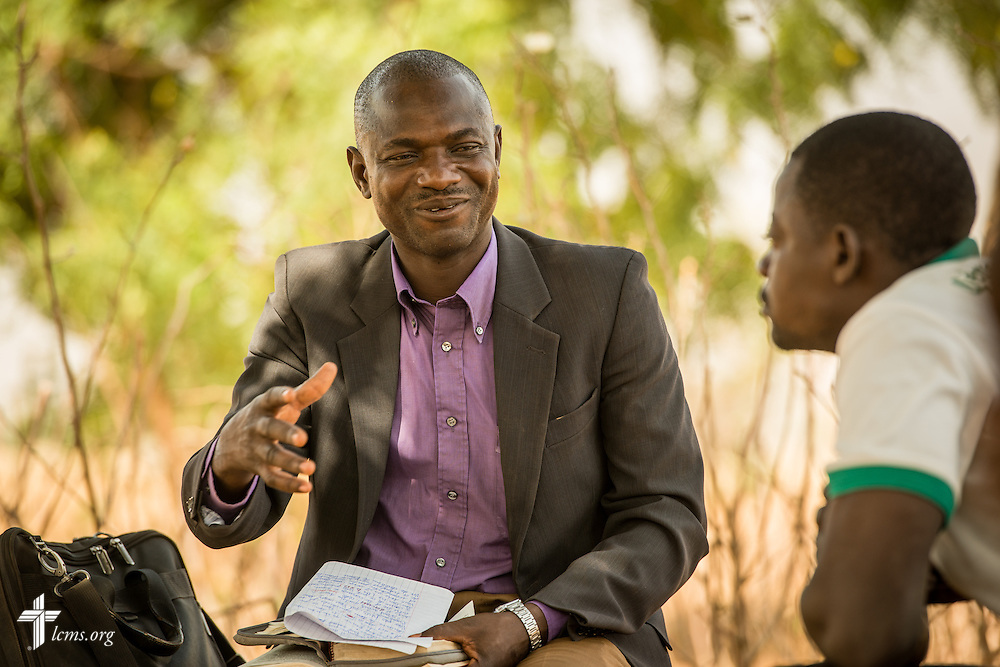 The Rev. Remi Lare Lambon, pastor in the Lutheran Church of Togo, shares a devotion with villagers on Tuesday, Feb. 14, 2017, at a rural home in Sankpong, Togo. LCMS Communications/Erik M. Lunsford