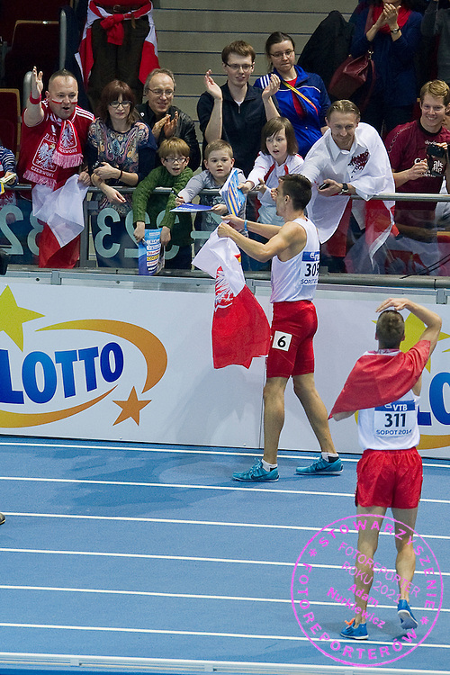 (L) Adam Kszczot and (R) Marcin Lewandowski both from Poland celebrate their medals after men's 800 meters final during the IAAF Athletics World Indoor Championships 2014 at Ergo Arena Hall in Sopot, Poland.<br /> Marcin Lewandowski of Poland was disqualified for leaving the track during the race and lost his bronze medal.<br /> <br /> Poland, Sopot, March 9, 2014.<br /> <br /> Picture also available in RAW (NEF) or TIFF format on special request.<br /> <br /> For editorial use only. Any commercial or promotional use requires permission.<br /> <br /> Mandatory credit:<br /> Photo by &copy; Adam Nurkiewicz / Mediasport