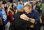 Dallas Cowboys head coach Jason Garrett gives a postgame hug to Detroit Lions head coach Jim Caldwell after the NFL week 18 NFC Wild Card postseason football game against the Detroit Lions on Sunday, Jan. 4, 2015 in Arlington, Texas. The Cowboys won the game 24-20. ©Paul Anthony Spinelli