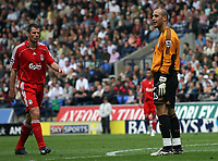 "Photo: Paul Thomas.<br /> Bolton Wanderers v Liverpool. The Barclays Premiership. 30/09/2006.<br /> <br /> Jose Reina of Liverpool (R) can't believe he gave away a penalty for ""handling"" out side the box."