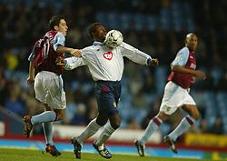 BIRMINGHAM, ENGLAND - Tuesday, January 6, 2004: Aston Villa's Peter Whittingham and Portsmouth's Aiyegbeni Yakubu during the Premiership match at Villa Park. (Pic by David Rawcliffe/Propaganda)