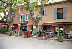 The tree-shaded Cafe du Cours is a welcome stop on the wine loop south of Vaison la Romaine.