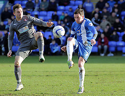 Peterborough United's Danny Swanson in action with Rotherham United's Lee Frecklington - Photo mandatory by-line: Joe Dent/JMP - Mobile: 07966 386802 22/03/2014 - SPORT - FOOTBALL - Peterborough - London Road Stadium - Peterborough United v Rotherham United - Sky Bet League One