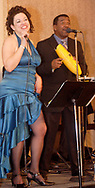 Gina Stough (left) and Sammy Paris perform with Son del Caribe at the 17th Artemis Center Gala, Saturday night.