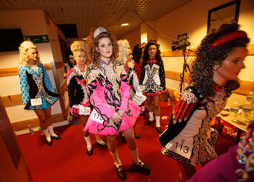 "Belgian Irish Dancer Alicia Bellemans, centre  number 115 (16) prepares to enter the stage. She got to Glasgow for The 46th annual World Irish Dancing Championships at the Glasgow Royal Concert Hall from March 20th- 27th 2016. From Brussels she is the first Belgian to have qualified for the Championships and were not letting the terrorist  attack and airport closures and transport problems beat them to fulfil their passion to compete at Irish Dancing. Alicia said "" We have to do what we love. We won't stop, they won't stop our passion for Irish dancing, we are afraid, but we fight"". Alicia had to be in Glasgow for her dance slot at 12.30. She has been on the move since 2am and finally got here via Amsterdam.  Picture Robert Perry 23rd March 2016<br /> <br /> Must credit photo to Robert Perry<br /> FEE PAYABLE FOR REPRO USE<br /> FEE PAYABLE FOR ALL INTERNET USE<br /> www.robertperry.co.uk<br /> NB -This image is not to be distributed without the prior consent of the copyright holder.<br /> in using this image you agree to abide by terms and conditions as stated in this caption.<br /> All monies payable to Robert Perry<br /> <br /> (PLEASE DO NOT REMOVE THIS CAPTION)<br /> This image is intended for Editorial use (e.g. news). Any commercial or promotional use requires additional clearance. <br /> Copyright 2014 All rights protected.<br /> first use only<br /> contact details<br /> Robert Perry     <br /> 07702 631 477<br /> robertperryphotos@gmail.com<br /> no internet usage without prior consent.         <br /> Robert Perry reserves the right to pursue unauthorised use of this image . If you violate my intellectual property you may be liable for  damages, loss of income, and profits you derive from the use of this image."