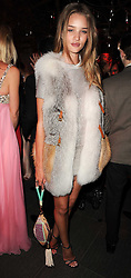 ROSIE HUNTINGTON-WHITELEY at The Love Ball hosted by Natalia Vodianova and Lucy Yeomans to raise funds for The Naked Heart Foundation held at The Round House, Chalk Farm, London on 23rd February 2010.