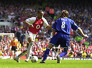 Premiership Football - Arsenal v Leicester City:.2003/04 Season - 15/05/2004  [Record breaking Season undefeated] .Thierry Henry,  run's the ball at Lilian Nalis.[Credit] Peter Spurrier Intersport Images