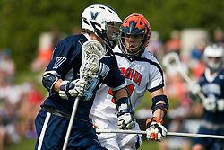 Villanova Wildcats Midfield Matthew Fritts (4) is defended by Virginia Cavaliers D Chris Conlon (41).  The #5 ranked Virginia Cavaliers defeated the #19 ranked Villanova Wildcats 18-6 in the first round of the 2008 NCAA Men's Lacrosse Tournament the University of Virginia's Klockner Stadium in Charlottesville, VA on May 10, 2009.