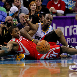 April 19, 2012; New Orleans, LA, USA; New Orleans Hornets power forward Carl Landry (24) and Houston Rockets point guard Kyle Lowry (7) are get tied up on a loose ball during the second half at the New Orleans Arena. The Hornets defeated the Rockets 105-99.   Mandatory Credit: Derick E. Hingle-US PRESSWIRE