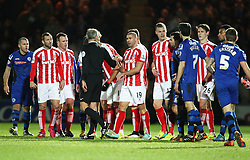 A fight breaks out after Rochdale's Peter Vincenti fouls Stoke City's Bojan Krkic  - Photo mandatory by-line: Matt McNulty/JMP - Mobile: 07966 386802 - 26/01/2015 - SPORT - Football - Rochdale - Spotland Stadium - Rochdale v Stoke City - FA Cup Fourth Round