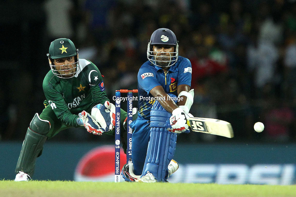 Mahela Jayawardene sweeps the delivery from Saeed Ajmal during the ICC World Twenty20 semi final match between Sri Lanka and Pakistan held at the Premadasa Stadium in Colombo, Sri Lanka on the 4th October 2012<br /> <br /> Photo by Ron Gaunt/SPORTZPICS