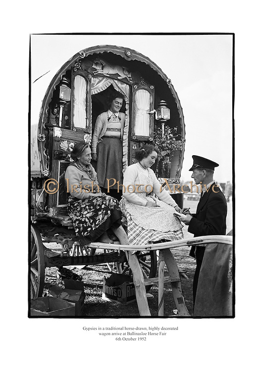 Gypsies in a traditional horse-drawn, highly decorated wagon arrive at Ballinasloe Horse Fair.<br />