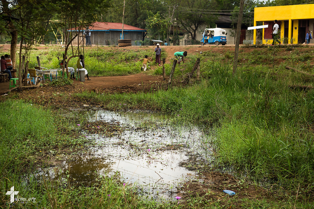 Pools of water that can lead to mosquito growth soak the ground in Itang, Ethiopia, on Saturday, Nov. 15, 2014. LCMS Communications/Erik M. Lunsford